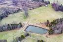 Drone shots over the pond - 3374 TWYMANS MILL RD, ORANGE