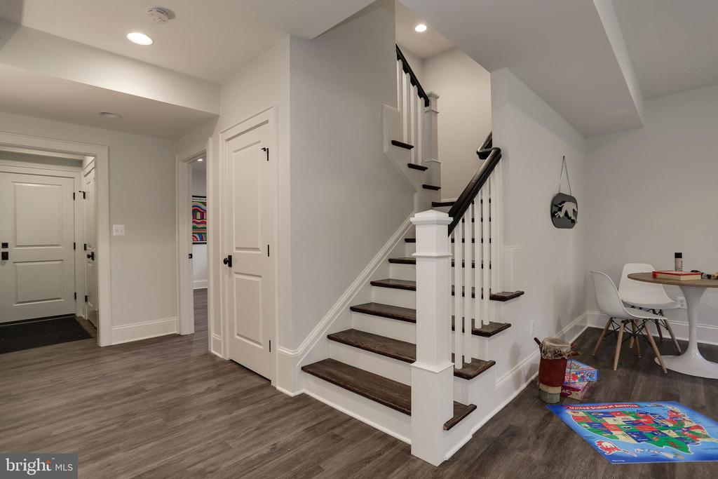 welcoming lower level with Coretec  floors - 5010 25TH RD N, ARLINGTON