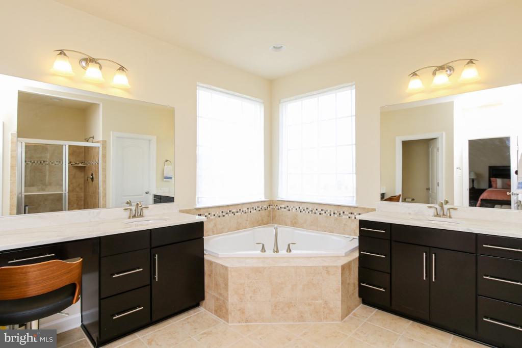 Master bath with tile floors, separate vanities - 1917 WETTERHORN CT, FREDERICK