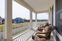 You'll love relaxing on the second story porch - 23065 CHAMBOURCIN PL, ASHBURN