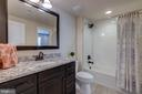 Full bath  in lower level w/ comfort height vanity - 23065 CHAMBOURCIN PL, ASHBURN
