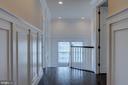 Craftsmanship blends seamlessly throughout hallway - 23065 CHAMBOURCIN PL, ASHBURN