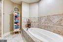 Relaxing soaking tub in Jack n Jill Bathroom - 13509 PATERNAL GIFT DR, HIGHLAND