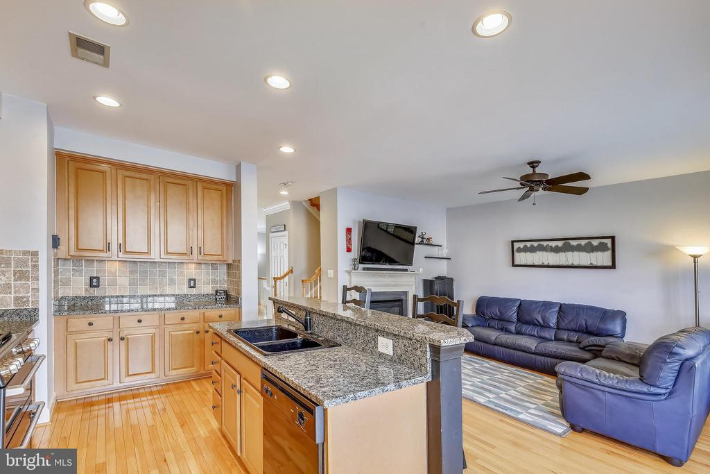 Kitchen Family Room Combo is heart of the home. - 147 HERNDON MILL CIR, HERNDON