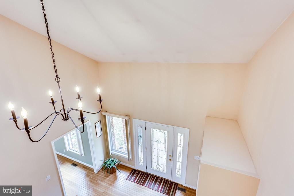 VIEW OF FOYER FROM UPPER LEVEL STAIR RAILING - 7365 BEECHWOOD DR, SPRINGFIELD