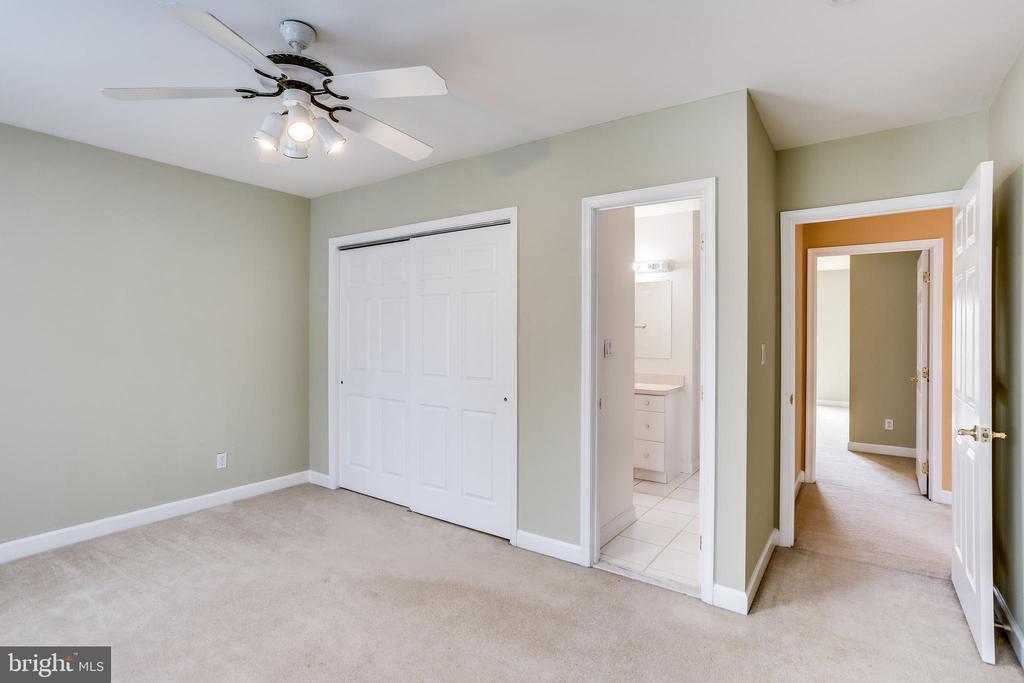 UPPER LEVEL FRONT BEDROOM HALL TO REAR BEDROOM - 7365 BEECHWOOD DR, SPRINGFIELD