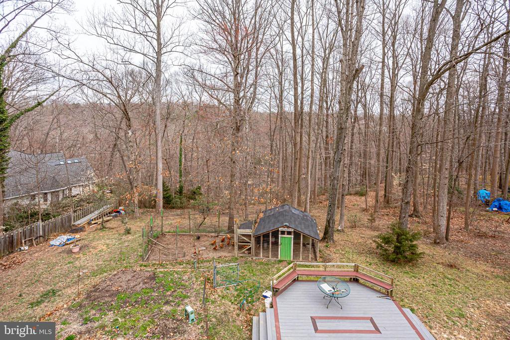 PRIVATE VIEW OF BACK YARD FROM MAIN LEVEL DECK - 7365 BEECHWOOD DR, SPRINGFIELD