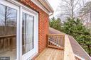 UPPER LEVEL BALCONY  DOUBLE GLASS DOORS TO BEDROOM - 7365 BEECHWOOD DR, SPRINGFIELD