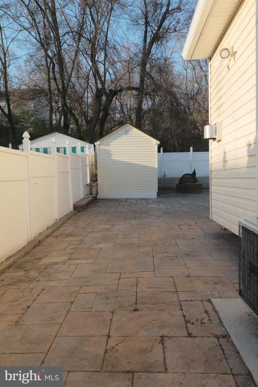 Sides and rear of house paved patio - 5717 KOLB ST, FAIRMOUNT HEIGHTS