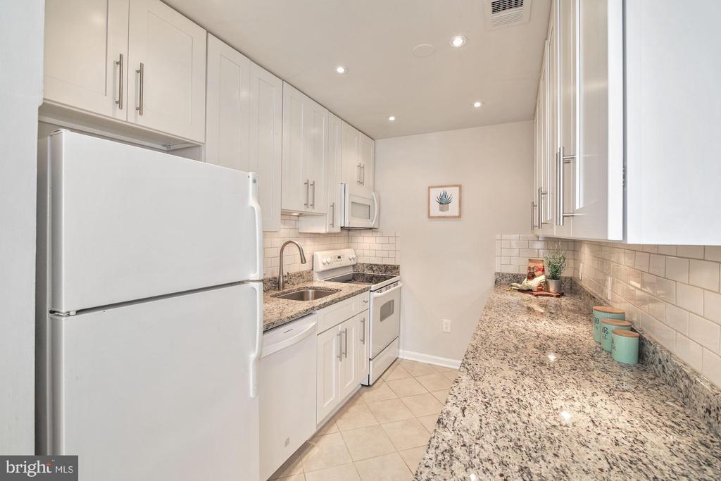Kitchen off of dining room on 2nd level! - 3747 KANAWHA ST NW, WASHINGTON