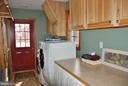 Separate laundry room with counter & cabinetry - 1318 LOCUST GROVE CHURCH RD, ORANGE