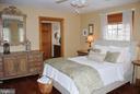 Master bedroom with door into master bath - 1318 LOCUST GROVE CHURCH RD, ORANGE