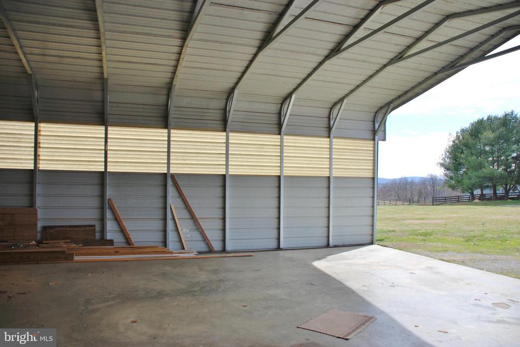 Metal run in shed with concrete floor - 1318 LOCUST GROVE CHURCH RD, ORANGE