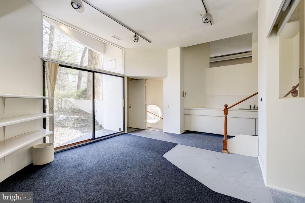 Family room, wet bar, garage entrance - 5500 BROAD BRANCH RD NW, WASHINGTON