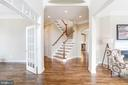 Front Foyer w/Refinished Floors & Stairs to Match - 18777 UPPER MEADOW DR, LEESBURG