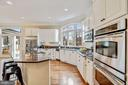Freshly Painted Kitchen Cabinets with SS Appliance - 18777 UPPER MEADOW DR, LEESBURG