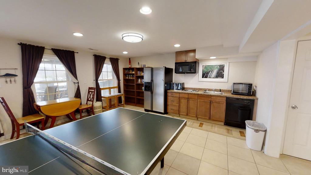 Wet bar in the basement with a refrigerator - 24186 LANDS END DR, ORANGE