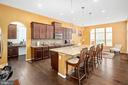 granite island is the focal point of this kitchen - 31 LIBERTY KNOLLS DR, STAFFORD