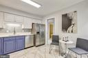 Refreshed Kitchen with Seating - 2111 WISCONSIN AVE NW #PH7, WASHINGTON