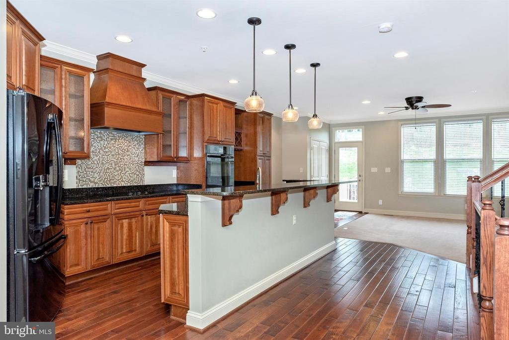 Kitchen with huge multi-level granite island - 6961 COUNTRY CLUB TER, NEW MARKET
