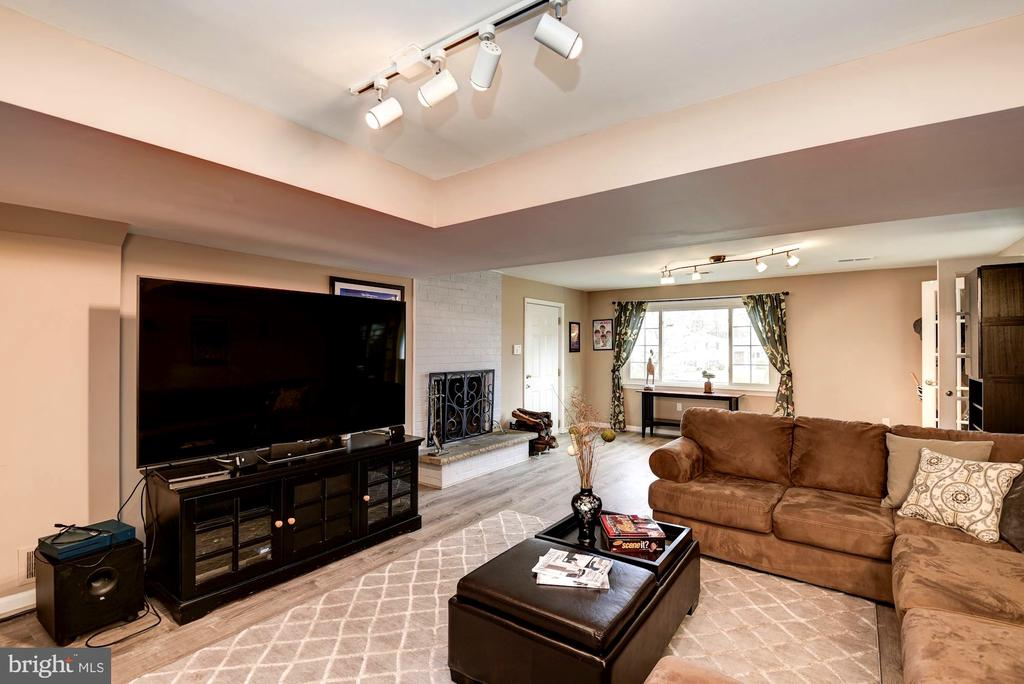 Media Room Also Features Wood Fireplace - 8902 TRANSUE DR, BETHESDA
