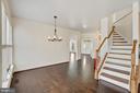 Hand carved rail, high ceilings, custom lighting. - 43988 RIVERPOINT DR, LEESBURG