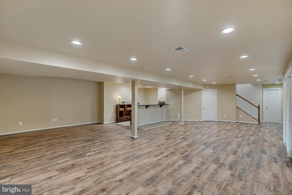 Entertain in LL rec room w/ 'Barnwood' flooring. - 43988 RIVERPOINT DR, LEESBURG