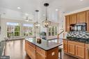 Kitchen opens to family & huge deck for gathering. - 43988 RIVERPOINT DR, LEESBURG