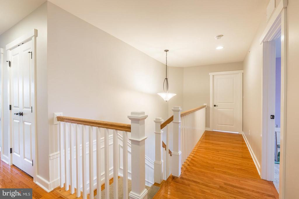 At the end of the upper hall is the laundry room - 17109 GULLWING DR, DUMFRIES