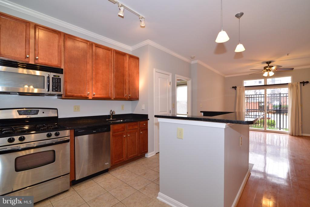 Open floor plan!  View of community pool! - 2655 PROSPERITY AVE #119, FAIRFAX