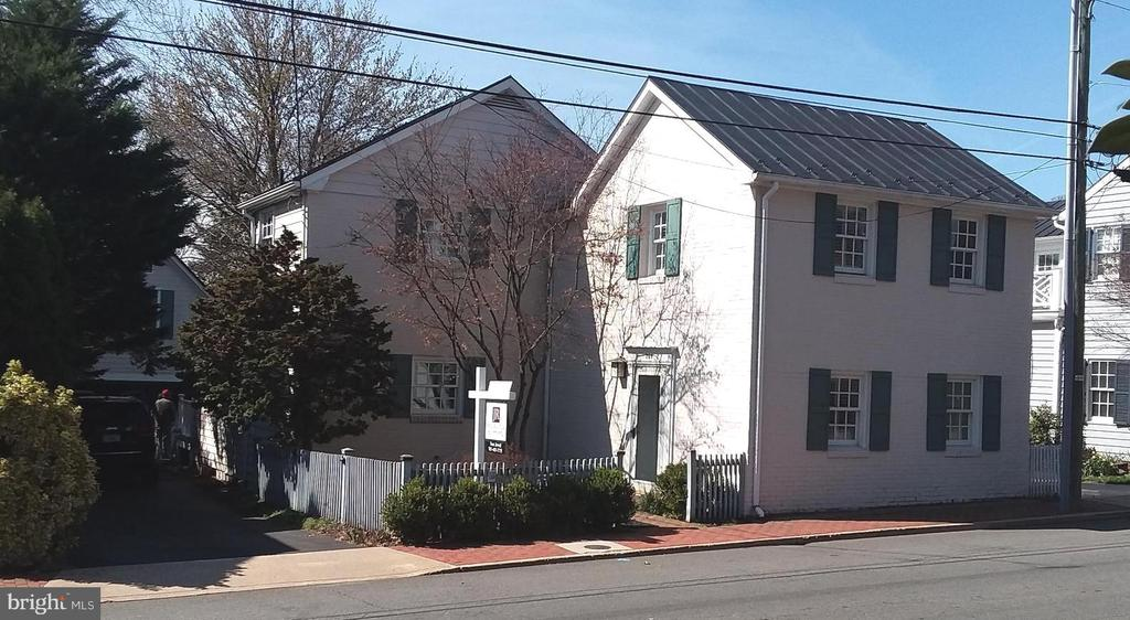 Brick house has metal roof, character and charm. - 239 W MARKET ST, LEESBURG