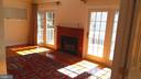 French doors flank antique mantel and fireplace. - 239 W MARKET ST, LEESBURG