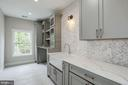 Upper level laundry room with abundant cabinetry - 1916 RHODE ISLAND AVE, MCLEAN