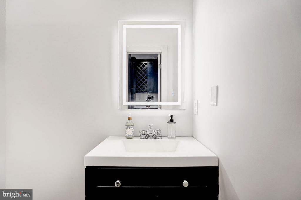 Main level powder room w/ smart/green lighting - 1332 RIGGS ST NW, WASHINGTON