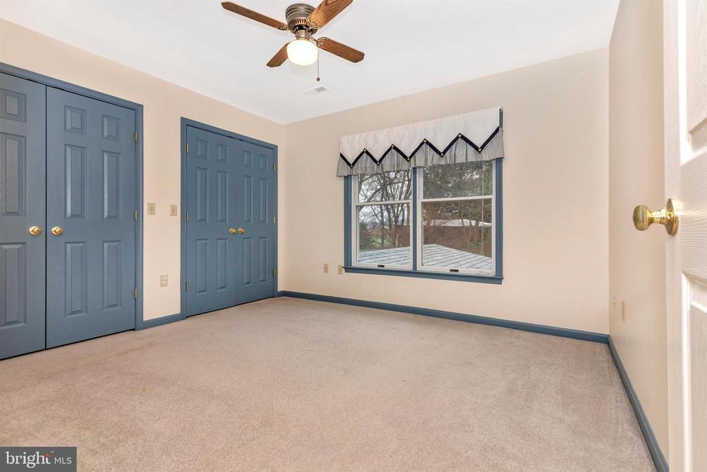 Bedroom 2 with ceiling fan. - 7799 COBLENTZ RD, MIDDLETOWN