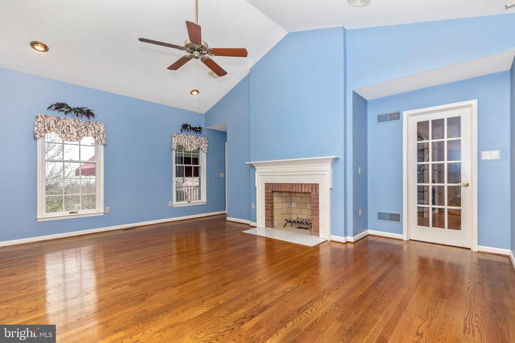 Another fireplace in this sunny room. - 7799 COBLENTZ RD, MIDDLETOWN