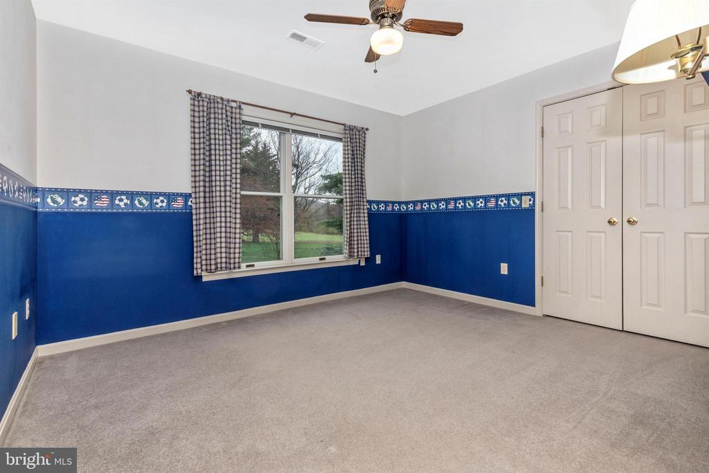 Bedroom 3 with ceiling fan. - 7799 COBLENTZ RD, MIDDLETOWN