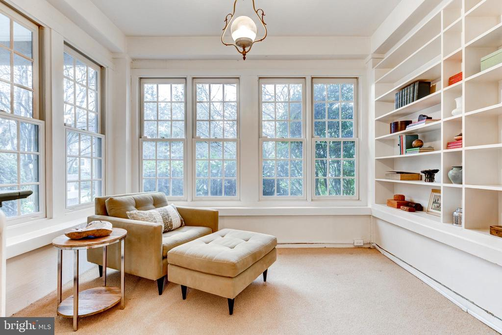 Den with built ins and wall of windows - 3715 BRADLEY LN, CHEVY CHASE