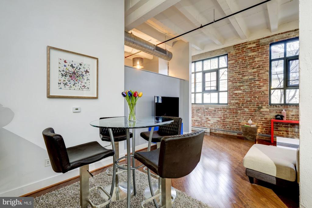 Open living room and dining room space - 1701 KALORAMA RD NW #206, WASHINGTON