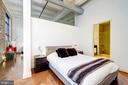 Bedroom with vaulted ceilings and loft styling - 1701 KALORAMA RD NW #206, WASHINGTON