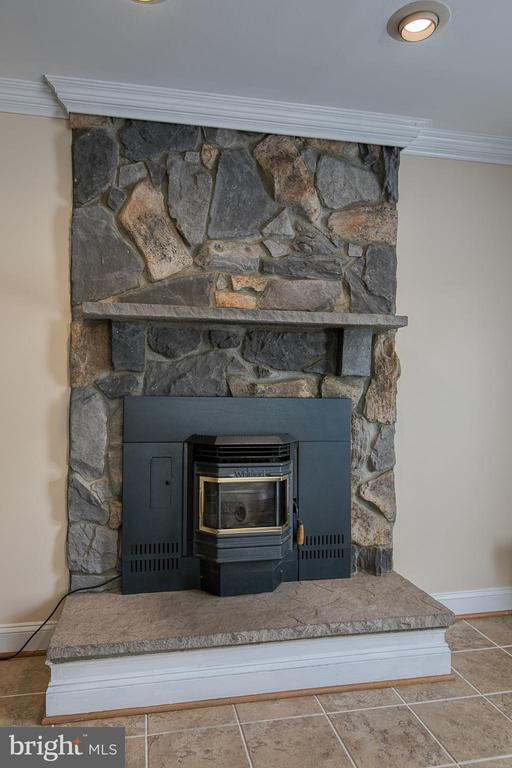 Pellet stove with ceiling to floor stone - 5 EMERSON CT, STAFFORD