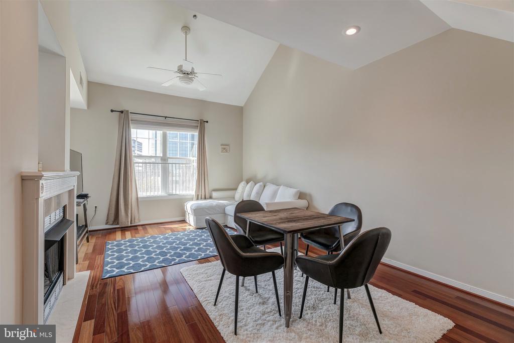 Dining room with hardwood floors - 1645 INTERNATIONAL DR #407, MCLEAN