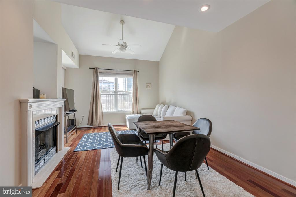 Dining room with gas fire place - 1645 INTERNATIONAL DR #407, MCLEAN