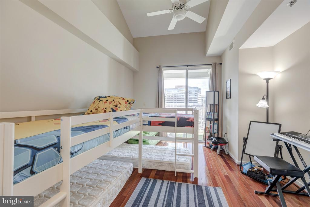 Main level bedroom with fan and balcony - 1645 INTERNATIONAL DR #407, MCLEAN