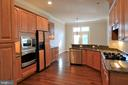Kitchen open to Eat-in Area - 18441 LANIER ISLAND SQ, LEESBURG