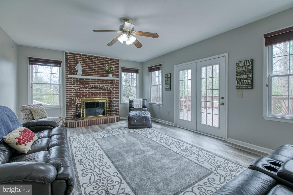 Family room provides access to the oversized  deck - 58 BALDWIN DR, FREDERICKSBURG