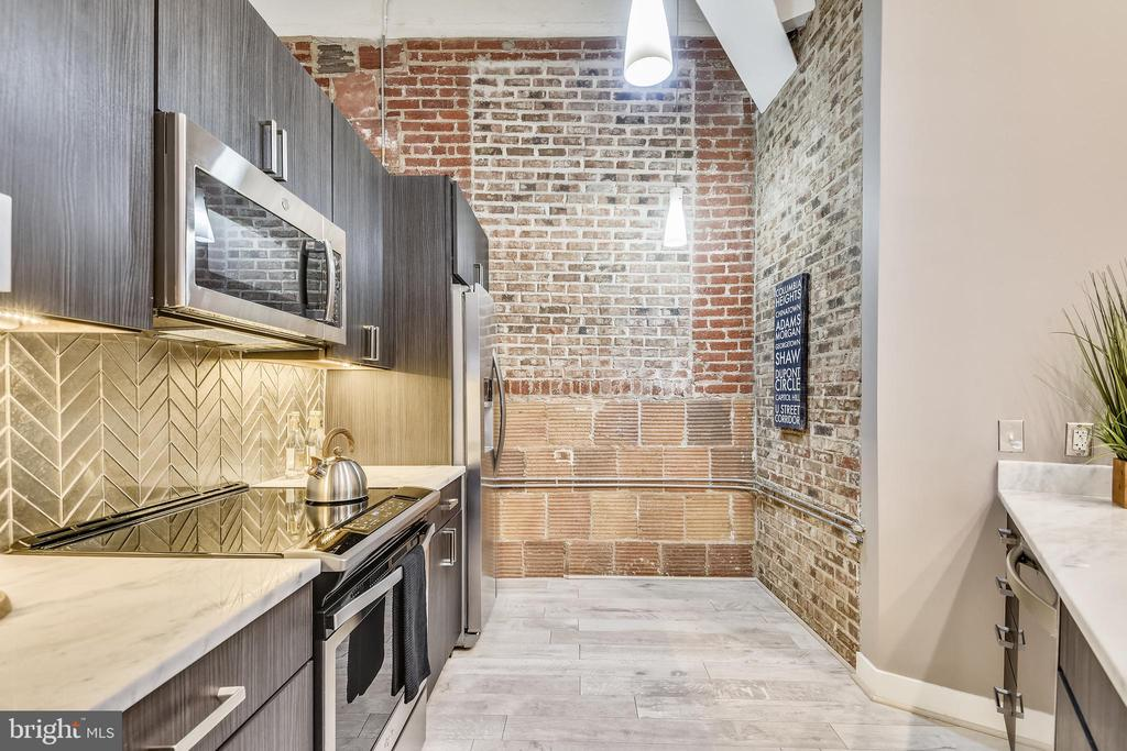 Exposed Brick, Concrete and Glass Herringbone Tile - 1701 KALORAMA RD NW #314, WASHINGTON