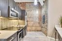 Exposed Brick, Concrete and Glass Herringbone Tile - 1701 KALORAMA RD NW #314, WASHINGTON