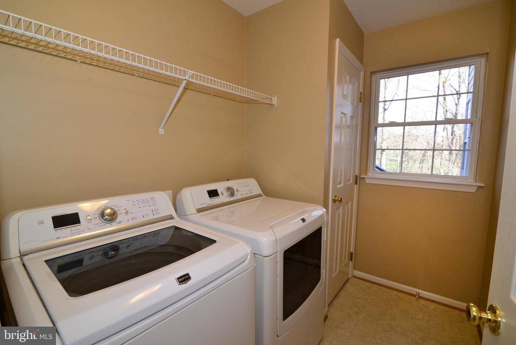 Bedroom laundry with Maytag washer/dryer - 1439 HARLE PL SW, LEESBURG