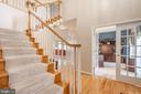 Wood staircase leading to upper level - 28 FIREBERRY BLVD, STAFFORD